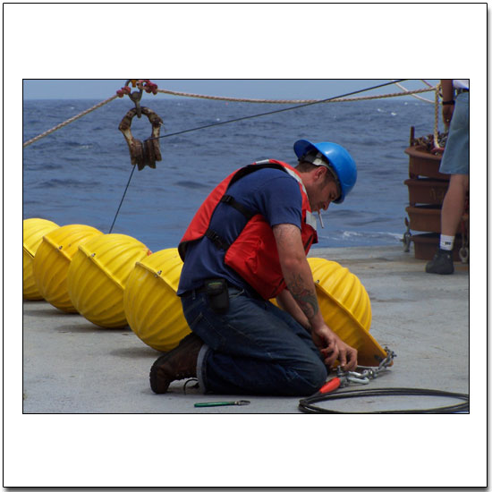 "Getting ""hard hat"" floats ready for a mooring"